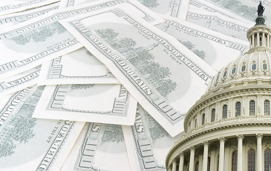 Image of $100 dollar bills and U.S. Capitol building