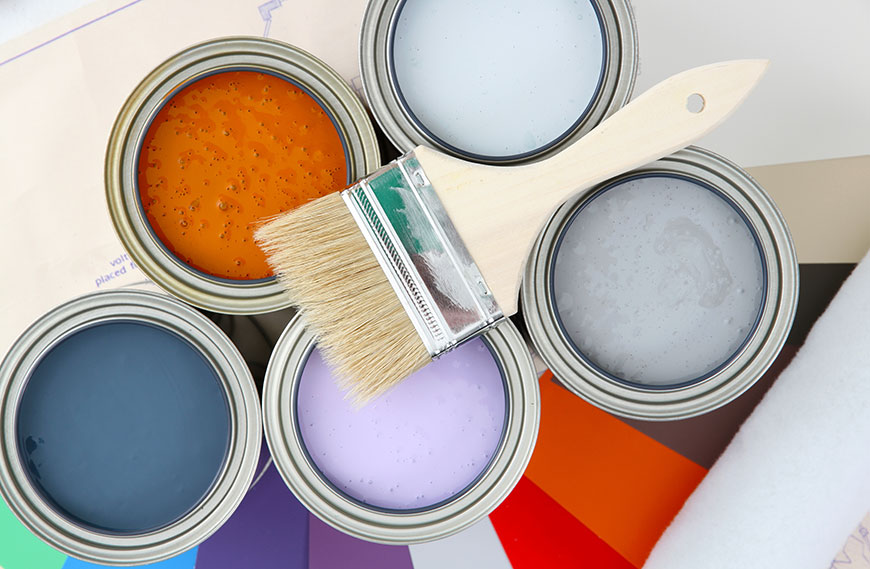 Image of colorful paint cans with brush on top for home improvement using home equity line of credit