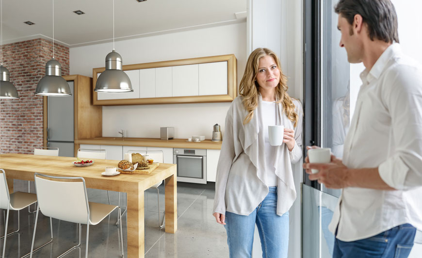 Couple standing in a kitchen