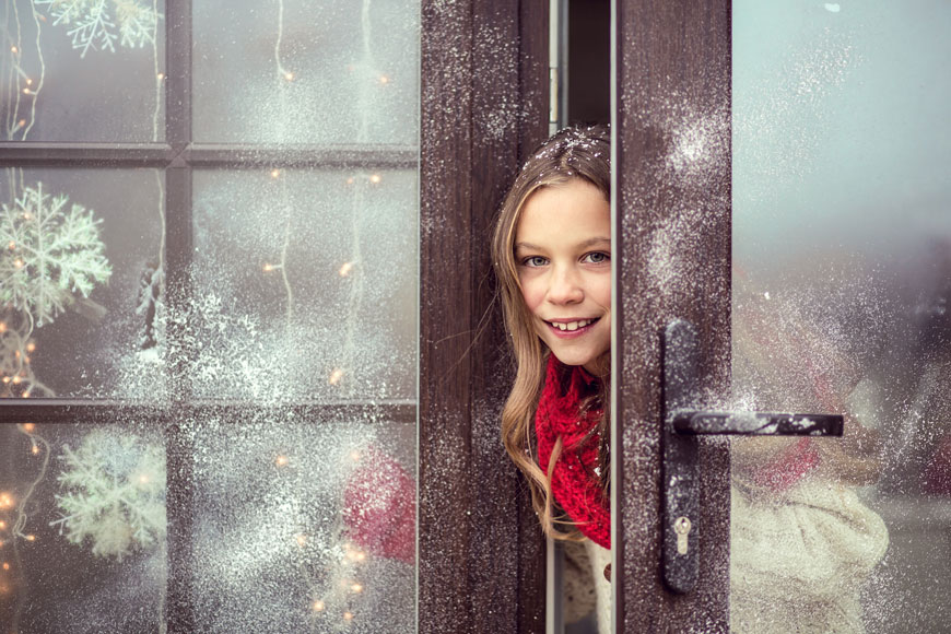 Girl in a house decorated for winter holidays