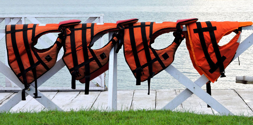 image of life vests on a railing