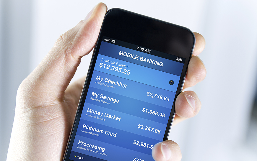 person holding smartphone with mobile banking on the screen