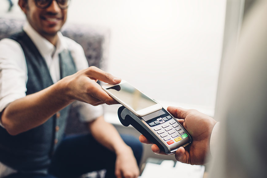 man paying with digital wallet