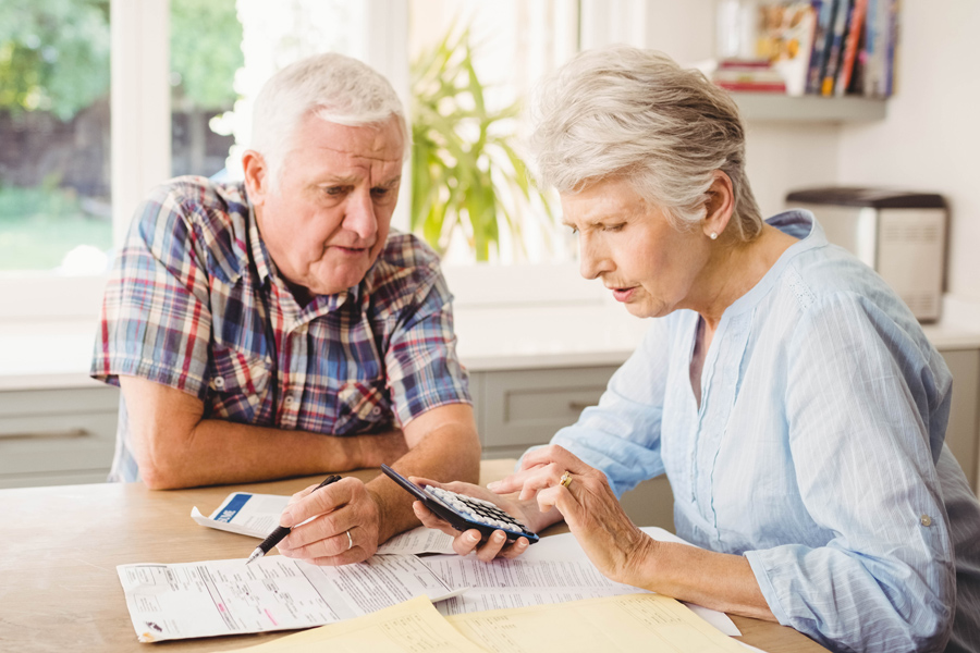 Older couple looking over finances