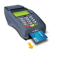 Card being removed from an EMV enabled chip terminal